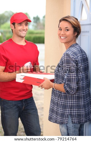 Pizza delivery at home - stock photo