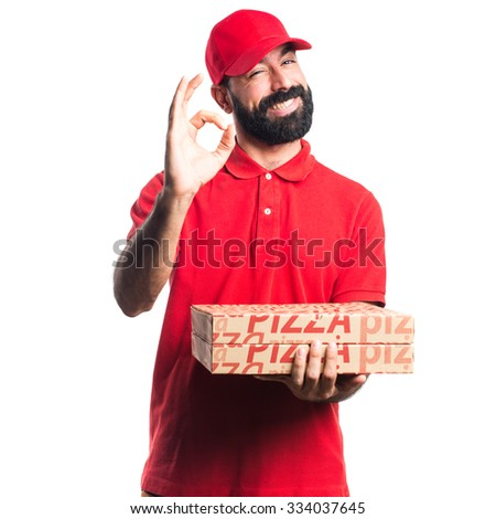 Pizza delivery man making OK sign - stock photo