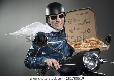 Pizza delivery. Man on motorbike holding pizza. - stock photo