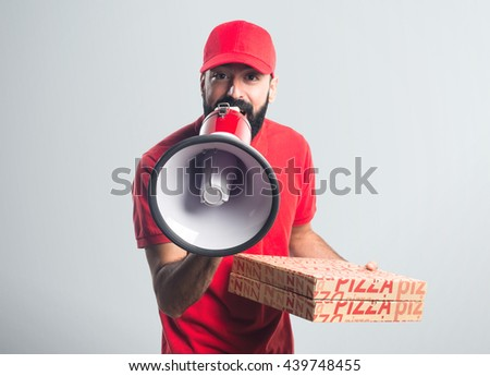 Pizza delivery man shouting by megaphone over grey background