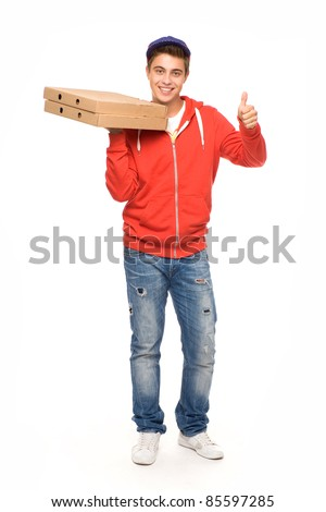 Pizza delivery man showing thumbs up - stock photo