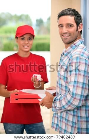 pizza delivery receiving payment - stock photo