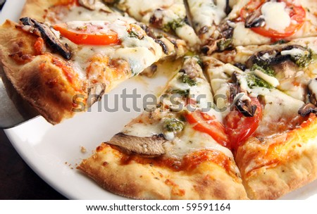 Pizza diavolo fresh from the oven - stock photo