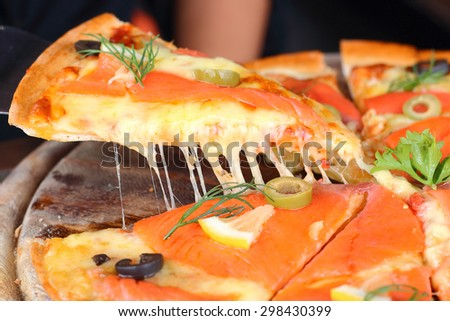 Pizza dough is crispy salmon and soft cheese. - stock photo