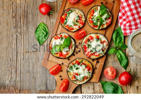 pizza eggplant with tomatoes and Basil. the toning. selective focus - stock photo