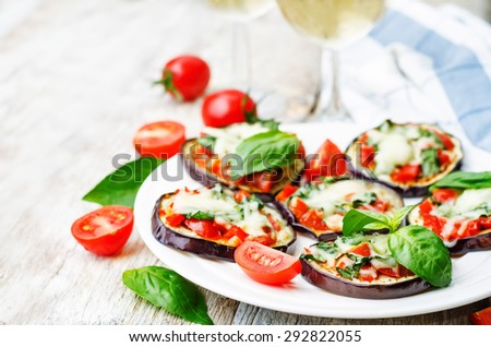 pizza eggplant with tomatoes and Basil. the toning. selective focus