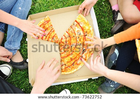 Pizza family picnic, eating outdoor together - stock photo