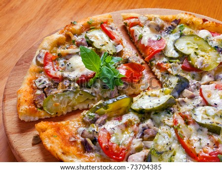 Pizza fast food with tomato and marinated cucumber
