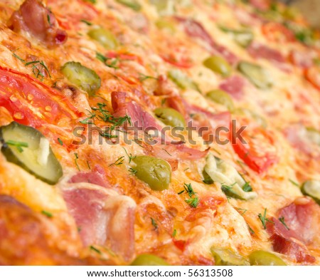pizza ham and vegetable close up. Shallow depth-of-field