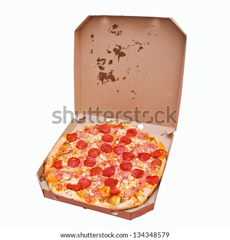 Pizza in a box. Tasty pizza with pepperoni sausage in white cardboard box isolated on white - stock photo