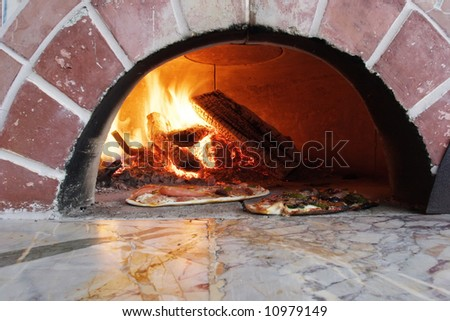 pizza in a wood burning pizza oven - stock photo