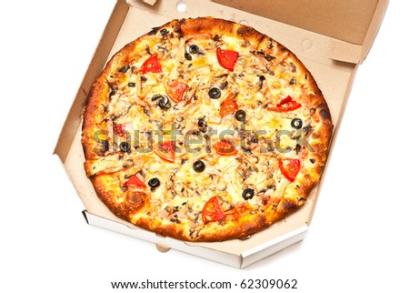 Pizza in open cardboard box isolated on white. Studio shot - stock photo