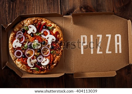 pizza in the in delivery box you can put your writing on the box - stock photo