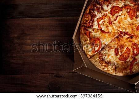pizza in the in delivery box you can put your writing on the wood - stock photo