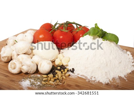 pizza ingredient on a wooden plate isolated over white - stock photo