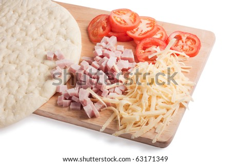 Pizza ingredients on cutting board, isolated on white - stock photo