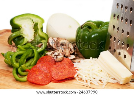 Pizza ingredients on wooden cutting board.  Isolated on white background. - stock photo