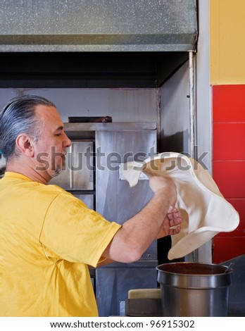 Pizza Making Tossing the crust - stock photo