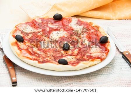 Pizza Margherita. Authentic Italian, hand made Pizza Margherita with tomatos, mozzarella cheese and oregano. Shallow DoF - stock photo