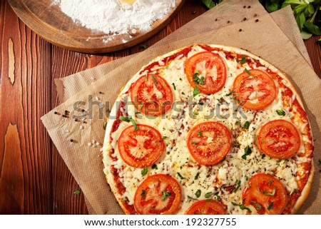 Pizza Margherita made with Tomatoes, Gauda Cheese and Mozzarella - stock photo