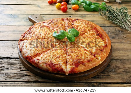 pizza margherita  on wooden rustic table background - stock photo