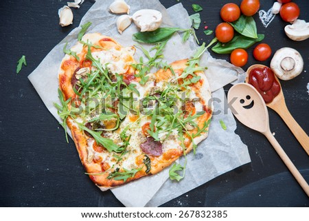 Pizza on a black - stock photo