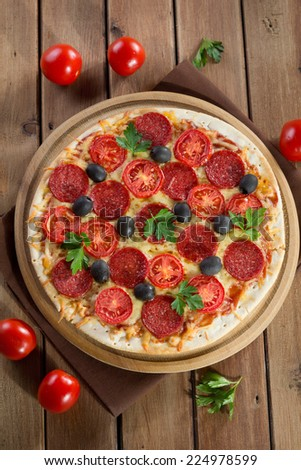 Pizza on a wooden background - stock photo