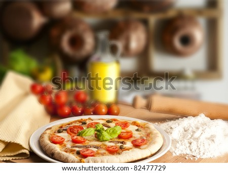 Pizza  on the table of kitchen