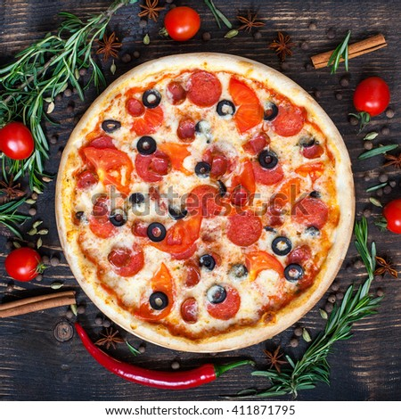 Pizza on wooden rustic desk