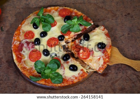 Pizza piece on a wooden shovel
