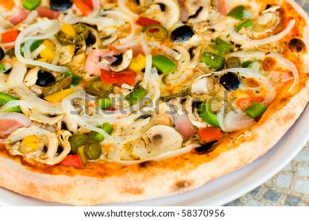 pizza salami,mushrooms and vegetable - stock photo