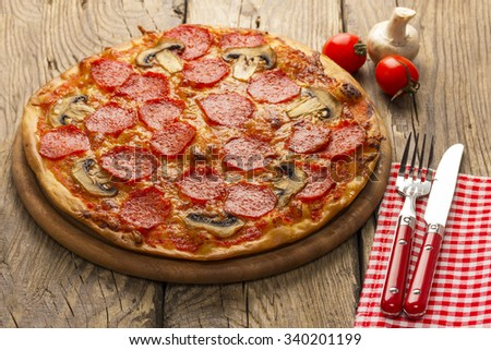 pizza served on wooden table - stock photo