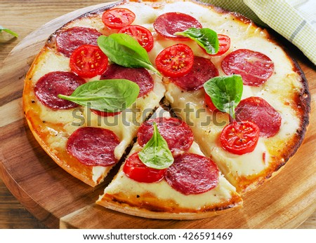 Pizza served on wooden table. Top view