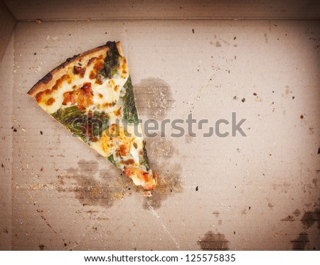 Pizza slice last one left in the pizza box - stock photo