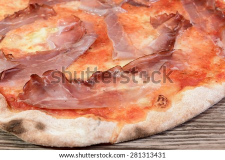 pizza speck and gorgonzola on wood - stock photo