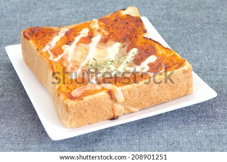Pizza toasted bread with tomato sauce and cheese  - stock photo