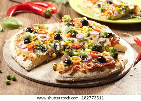 Pizza vegetarian on plate - stock photo