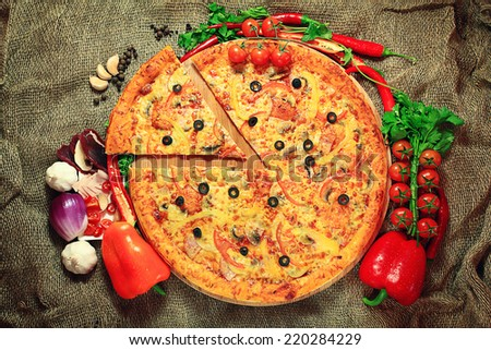 pizza with a slice cut, delicious pastries - stock photo