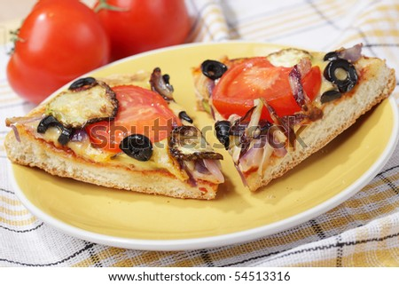 Pizza with aubergines, tomato, olives, onion, and cheese