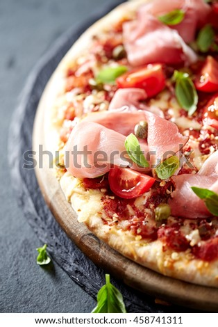 Pizza with Black Forest Ham, Cherry Tomatoes and Capers - stock photo