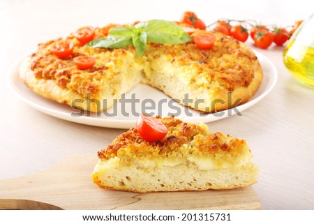 Pizza with breadcrumbs, onion and tomatoes on compex background - stock photo