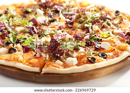Pizza with Cheese, Olives, Tomatoes and Salad Leaves