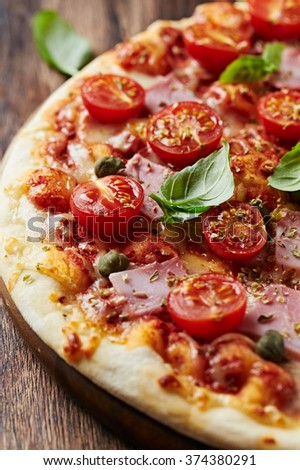 Pizza with cherry tomatoes and ham  - stock photo