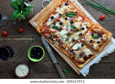 Pizza with chicken and bacon - stock photo