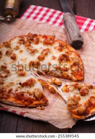 Pizza with chicken and mozzarella. selective focus - stock photo