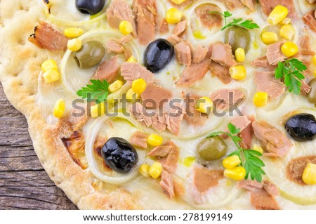 Pizza with corn, tuna, onions  and olives - stock photo