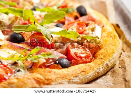 Pizza with dry cured ham and basil - stock photo