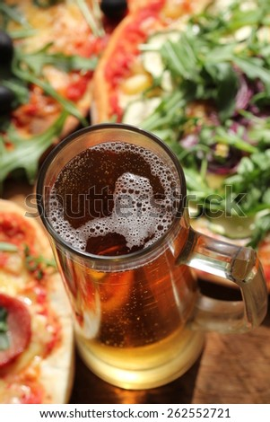 Pizza with glass of beer - stock photo
