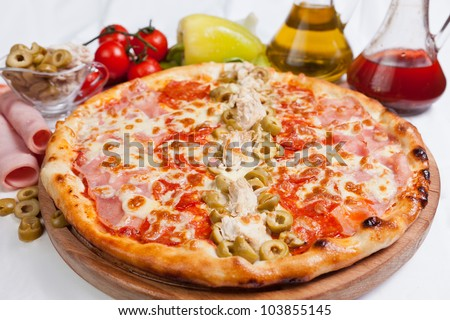 Pizza with green olives and ham - stock photo