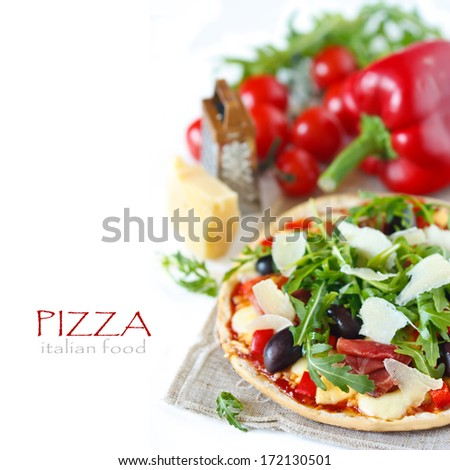 Pizza with ham and arugula on a white background.